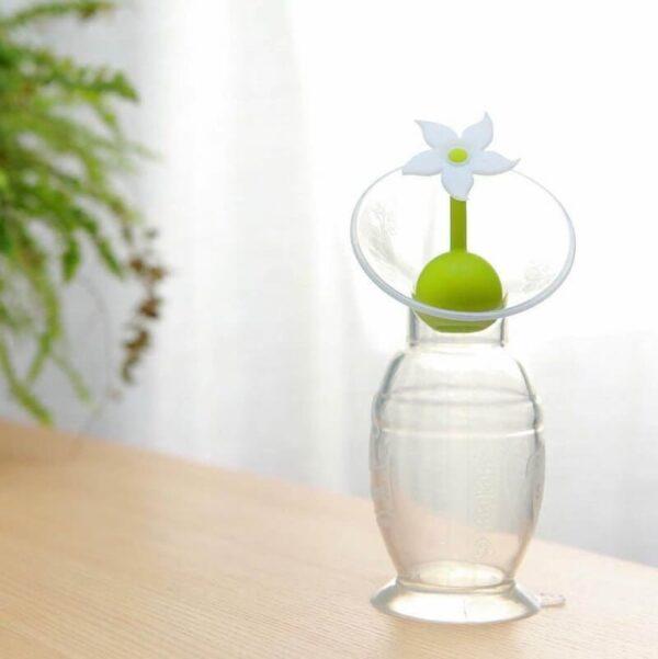 Le recueil lait Haaka avec le bouchon fleur blanc